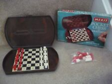 A VINTAGE MERIT POCKET CHESS SET AND DRAUGHTS WITH INLAID BOARD IN ORIGINAL BOX
