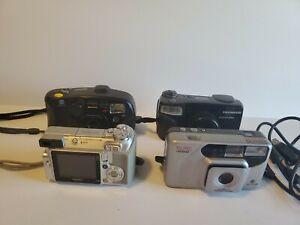 Lot of 4 Mix Cameras - Bell & Howell, Olympus, Minolta, Fujifilm. All Power On