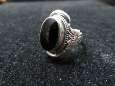 Sterling Silver Ring with Oval black Onyx and Butterfly Side Details