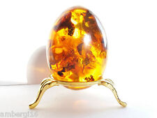 Amber Easter egg souvenir on a metal stand