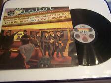 LP 33 TOURS VINYLE ,THE BEATLES ,REEL MUSIC AVEC PROGRAMME SOUVENIR . VG / VG +