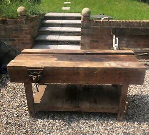 Lovely vintage old Pine wooden work shop bench with a vice