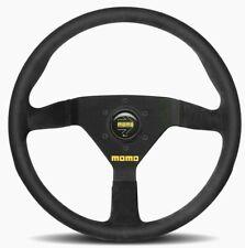 Genuine Momo Model Mod 78 black suede 3 spoke 350mm steering wheel and horn.