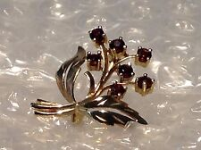 9ct YELLOW GOLD GARNET SET FLOWER AND LEAF BROOCH - Ref 1705.6