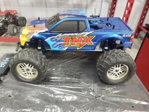 TAMIYA TNX PRO WITH POWER STROKE SHOCKS NITRO  terra crusher tmaxx mgt savage