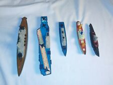 Five Tootsie Toy Ships great condition