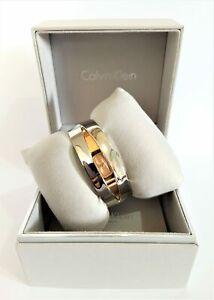 Calvin Klein K4T2SB1A Astonish Bronze Dial Silver Tone Bracelet Ladies Watch