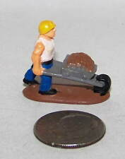 Very Small Plastic Figure of a Construction Worker with a Wheel Barrel