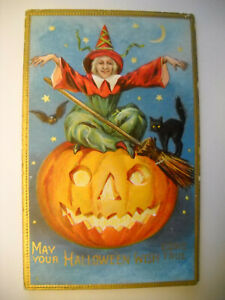 HALLOWEEN WITCH LEVITATES WITH CAT antique 1915 used embossed postcard CHROMO