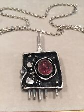 Sterling Silver pendant made by Walter Schluep with genuine Amethyst
