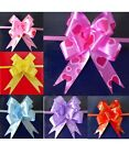 50 LARGE Ribbon Bows assorted colours easy pull flower ribbon party decorations.