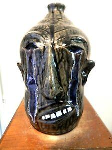 wayne hewell  face jug, pottery, folk art  10''x 7''