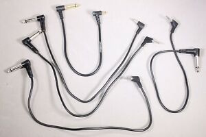 """Eight Used 1/4"""" to Mini Sync Cords"""