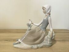 lladro Figurine - Reclining Girl on Rocks with a White Dove Bird on a Branch