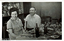1967 Photo of happy Russian couple at a festive table with food and vine