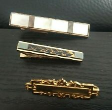 Group of three vintage tie clips / tie bars (Hickock, Stratton gilt)