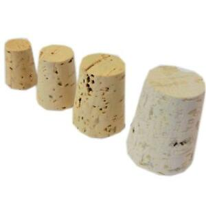 Cork stoppers in various sizes . Natural tapered corks , Corks- Bungs