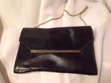 A21 Vintage black clutch, metal accent delicate metal strap snap closure leather