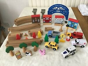 Wooden track, vehicles, buildings & more. 43 pieces