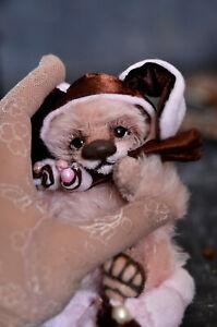 A bear cub in a bunny hat. ooak