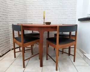 Mid-century round extending teak dining table and chairs
