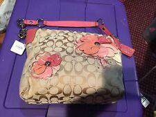 Coach khaki floral multicolor shoulder bag retailed for $398