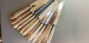 12 couteaux en metal argenté de chez E B
