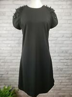 Betsey Johnson size 8 black sheath dress with sleeves accented with black pearls