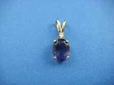 14K YELLOW GOLD AND OVAL IOLITE CLASSIC PENDANT WITH DIAMOND 8 x 6 MM 1 CT. T.W.