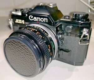 Canon AE-1 35mm film SLR camera in BLACK with FD 50mm f1.8 lens, strap & manual