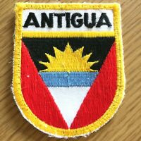 """Vintage ANTIGUA embroidered 2.5"""" X 3"""" patch COUNTRY CREST red, yellow & blue"""