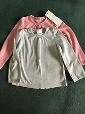 Two Childs Tops by F. & F. Pink.new/Grey-used. Size 18-24months.