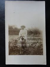 Old RPPC - Image of Lady Gardener showing old wooden wheel barrow