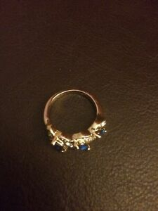 Dress Ring Blue And Clear Stones On Yellow Metal Band