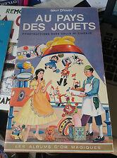 DISNEY Walt. Au pays des jouets. Constructions sans colle ni ciseaux. 1964.