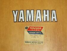 One pair of NOS Yamaha XS1 XS2 TX650 Gas Tank Emblems. 341-24161-02