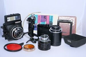 Graflex XL 6x9cm medium format camera outfit with 80mm, 100mm, and 150mm lenses.