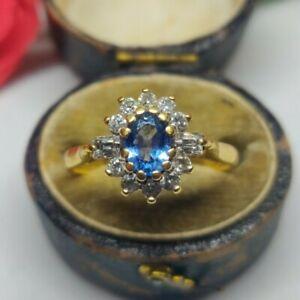 18ct gold UK hallmarked Ceylon Sapphire and Diamond Cluster ring. Blue stone