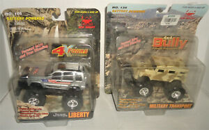 NEW BRIGHT 4 X 4 BULLY LOT OF 2 JEEP LIBERTY & MILITARY TRANSP RARE STOMPER KO'S