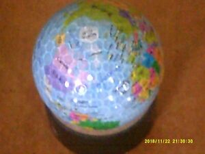 UNUSUAL RARE WORLD LOGO GOLF BALL NEW MINT GIVE SOMEONE THE WHOLE WORLD
