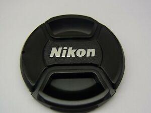 62mm Front Lens Cap Center Pinch Snap on for Nikon Camera Plastic OEM