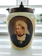 More details for a very beautiful blueish glass pot with a lovely portrait of queen victoria.