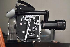 Bolex H16 M camera with a lens