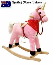 PLUSH KIDS ROCKING HORSE UNICORN MOVES AND SINGS WITH WOODEN STAND & SADDLE PINK