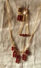 red necklace bracelet and earring set