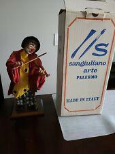 Vintage Sangiuliano Fabric Mache Clown playing violin figurine on wooden base.