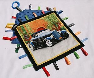 Taggie Blanket vintage car with blue dimple minky backing