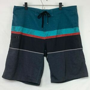 Burnside Mens Teal Hibiscus Board Shorts Black and Red Trim 1 Pkt Wax Comb Sz 38