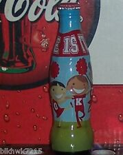 2011 WORLD OF COCA COLA CHEER COKE WRAPPED 8 OUNCE GLASS COCA COLA  BOTTLE