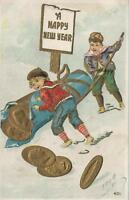 1908 USA GERMAN EMBOSSED BOYS MOVING ROLL of GOLD COINS HAPPY NEW YEAR POSTCARD